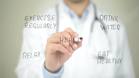 Health Care Concept, Doctor Writing on Transparent Screen
