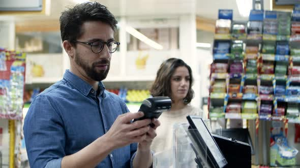Thumbnail for Man Paying with Credit Card in Supermarket