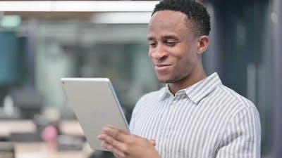 African Businessman Using Tablet Browsing Internet