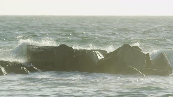 Waves crushing into rocks