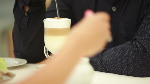 Thumbnail for Man's Hand Stirs Cappuccino