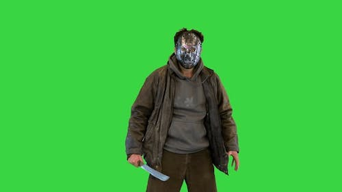 Jason Voorhees Looking at Camera and Waving Machete on a Green Screen Chroma Key