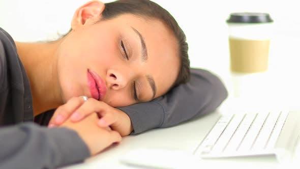 Thumbnail for Hispanic business woman resting head on desk