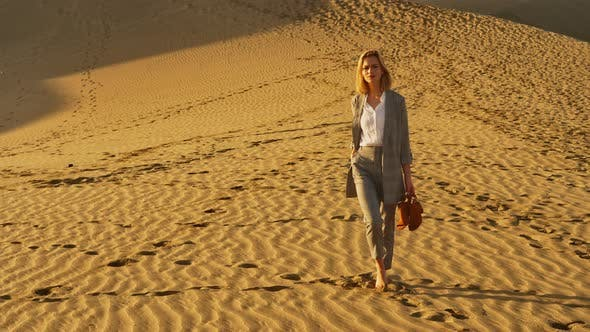 Thumbnail for Female Model in Business Attire Along the Sand Dunes