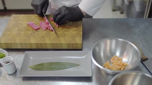 Thumbnail for Close Up Hands of Chef in White Restaurant Uniform Cutting Small Salmon Fish
