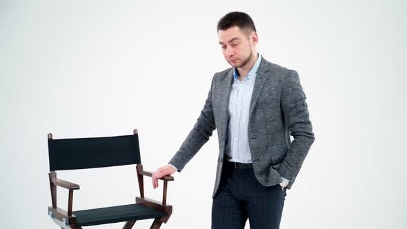 Thumbnail for Portrait of a young businessman in light studio