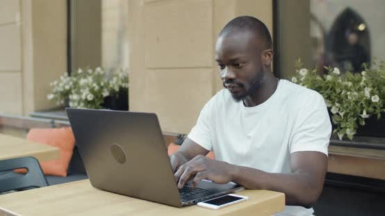 Afro American Student with Laptop