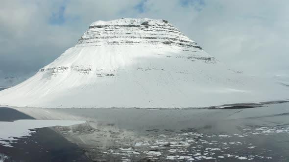 Thumbnail for Bird's-eye View of the Snowy Mount Kirkjufetl. Iceland, Winter 2019.