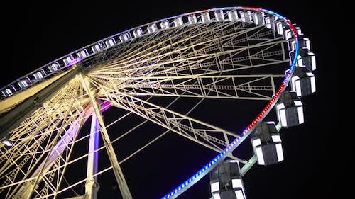 Huge Observation Wheel Stops Moving at Night Amusement Park, Entertainment