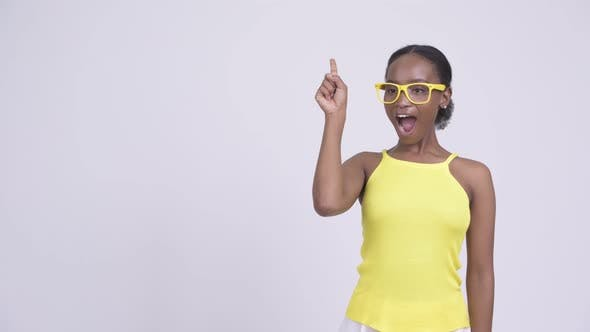 Thumbnail for Young Happy African Woman Thinking and Pointing Up