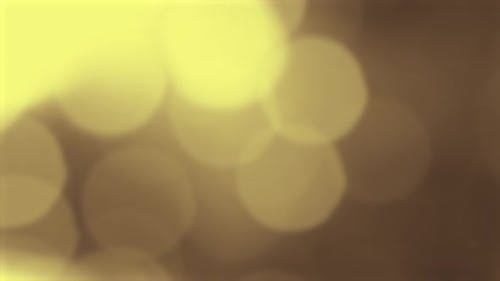Gold Yellow Bokeh Particles Background