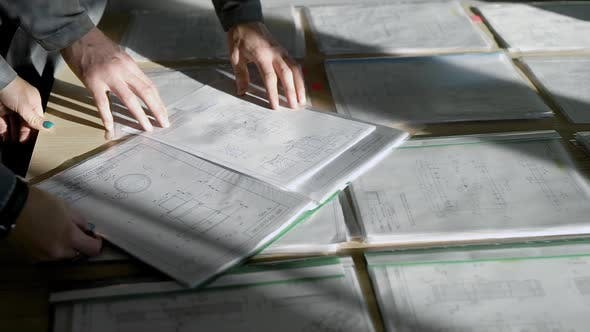 Thumbnail for Engineer Is Learning Technical Working Drawing of Detail for Production in Office