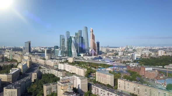 Thumbnail for Aerial View of Drone Moscow City Skyscrapers Through Sun Rays. Business Center of Moscow-city
