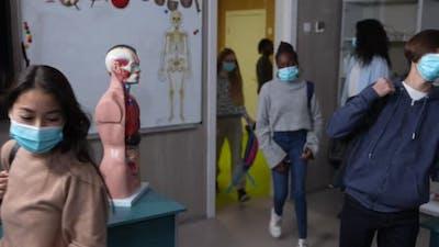 Teen Classmates in Face Masks Entering Classroom