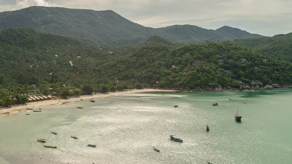 Thumbnail for Beautiful tropical beach with boats on a sea in Koh Phangan island, Thailand