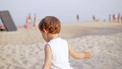 Cute Little Boy on Sandy Sea Beach