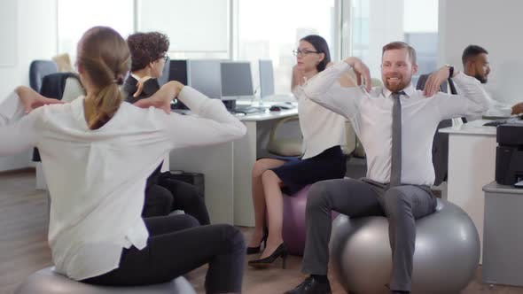 Thumbnail for Businesspeople Exercising at Workplace
