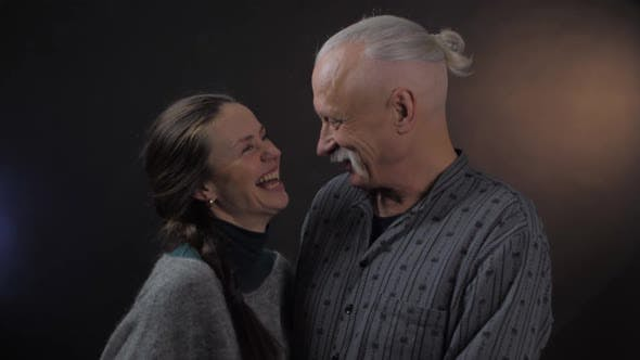 Thumbnail for Happy Retired Man and Pretty Woman Kiss Smile Laughing
