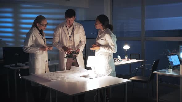 Thumbnail for Technology Research Facility: Multiracial Electronics Development Engineers in White Coats Working