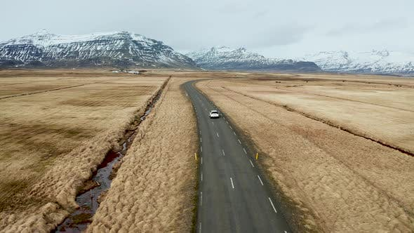Thumbnail for Beautiful Road on a Volcanic Landscape in Iceland. Drone Flying Behind the Car