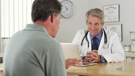 Thumbnail for Senior doctor listening to mature patient