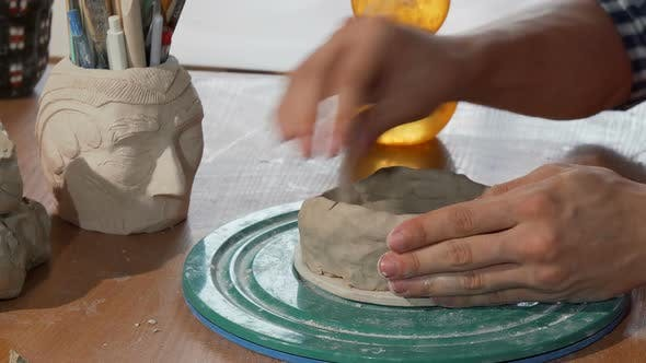 Thumbnail for Ceramics Artist Shaping Clay, Creating a Bowl at His Workshop