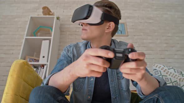 Thumbnail for Man in VR Glasses Playing Immersive Video Game