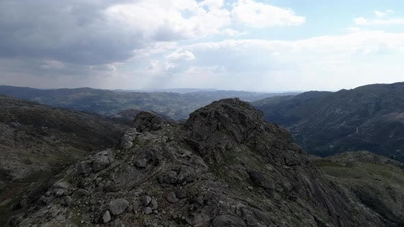 Thumbnail for Aerial High Rocky Cliff Peak