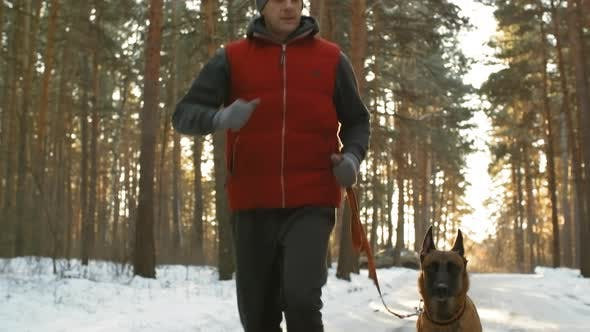 Cover Image for Man Jogging with Belgian Shepherd Dog