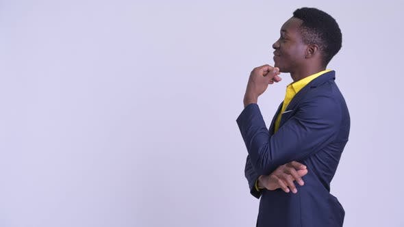Thumbnail for Profile View of Young Happy African Businessman Thinking