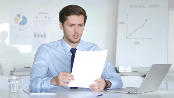 Thumbnail for Businessman Upset after Reading Documents