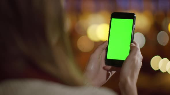 Thumbnail for Girl Hands Scrolling Mock Up Phone Outdoors, Woman Looking Phone Green Screen