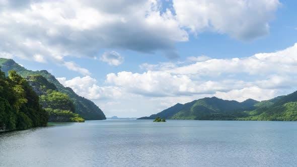 Beautiful lake reservoir and mountain in Kanchanaburi, Thailand - Time Lapse