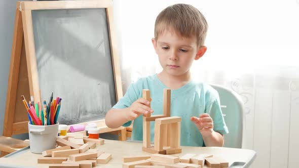 Thumbnail for Portrait of Little Boy Playing with Wooden Toy Blocks and Building Tower From Bricks