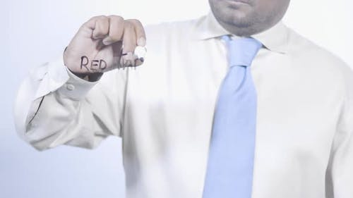 Asian Indian Businessman Writes Red Tape