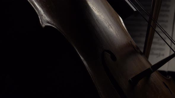 Thumbnail for Cello in the Dark Bow Bow on the Strings Behind the Notes