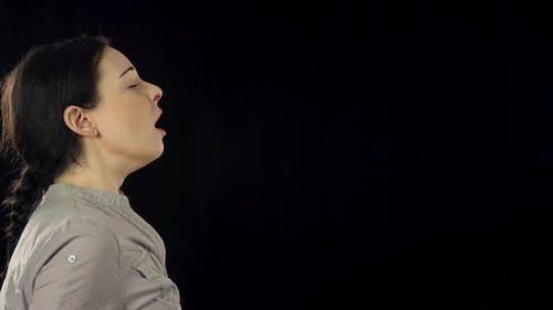 Woman Sneezing Slow Motion