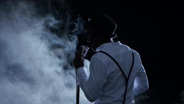 Thumbnail for Male African American Musician the View From the Back in the Smoke Singing in a Recording Studio