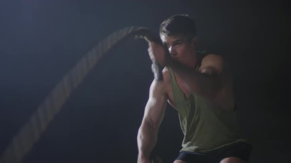 Thumbnail for Sequence of Man Training with Battle Ropes