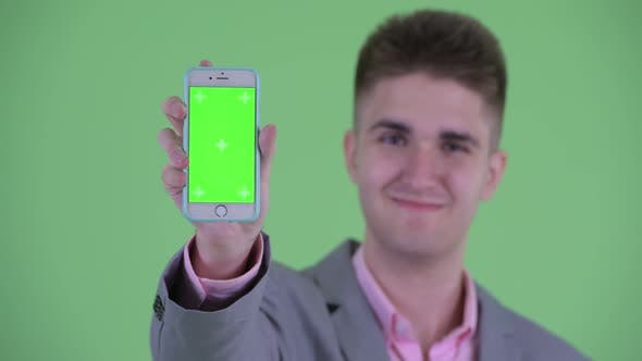 Thumbnail for Face of Happy Young Businessman Showing Phone