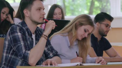 Students Writing in University