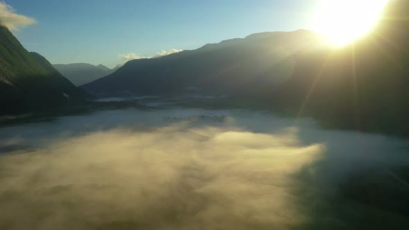 Thumbnail for Morning Mist Over the Valley Among the Mountains in the Sunlight