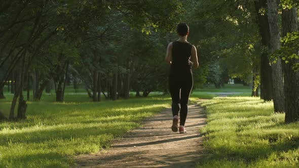 Thumbnail for Young Woman Runs On A Footpath