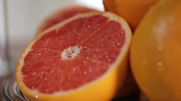 Thumbnail for Fresh Grapefruits on the Plate, Prepared Birthday Table With Fruits Closeup