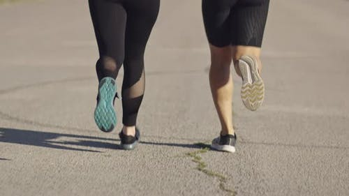 Close Up Slow Motion Fit Couple Jogging Exercising Running Cardio Workout