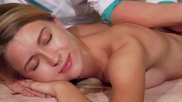 Thumbnail for Gorgeous Female Client Relaxing While Getting Body Massage