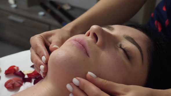 Thumbnail for Female Massaging Womans's Face at Spa