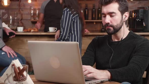 Thumbnail for Portrait of a Young Caucasian Male Working on His Business Remotely