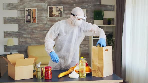 Man in Hazmat Suit Packing Food