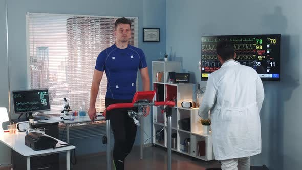 Thumbnail for Scientific Sports Laboratory: Doctor Coming To Monitor Athlete's Stress Testing